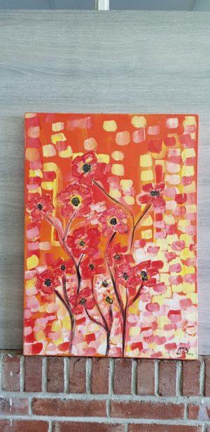 Een mooi schilderij met rode en oranje lente bloemen