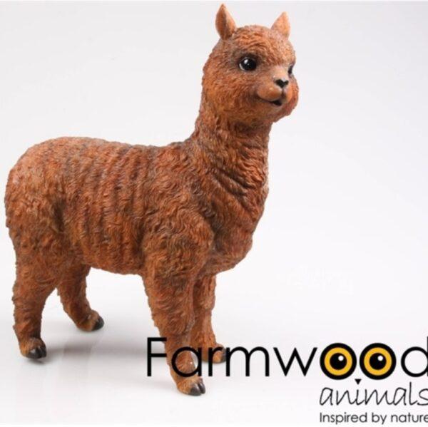 Een polyester beeldje van een bruine alpaca