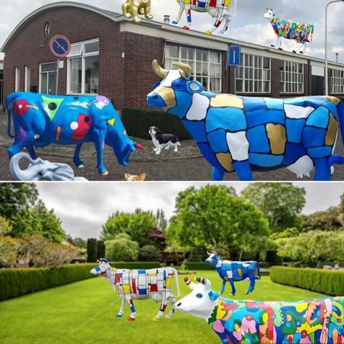 beschilderde beelden van polyester koeien, paarden en olifanten